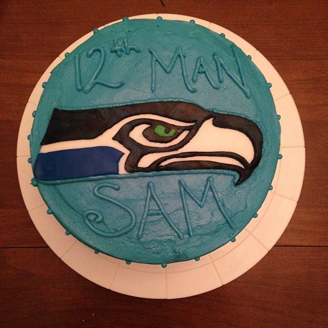 my Seahawks cake!  (dark chocolate cake, cream cheese frosting, hand made Seahawk in fondant) #12THMAN