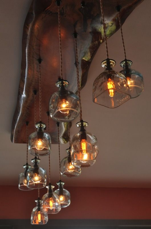 This amazing recycled Patron Bottle chandelier is made from a live edge piece of Eucalyptus from Seattle Washington