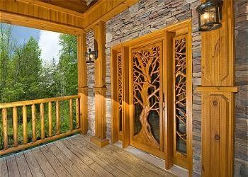 Carved Doors for Log Homes | Shut the Front Door (love that carving) | Log home living