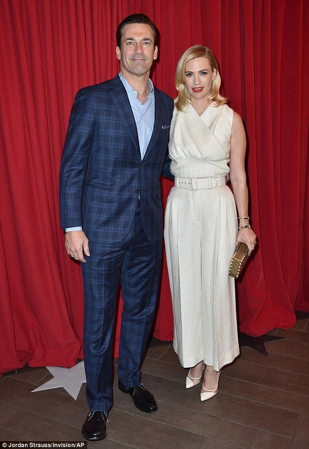 Still close: Jon Hamm and January Jones can't get enough of each other as they were seen arm-in-arm at the AFI Awards inside the Four Seasons Hotel in Los Angeles on Friday
