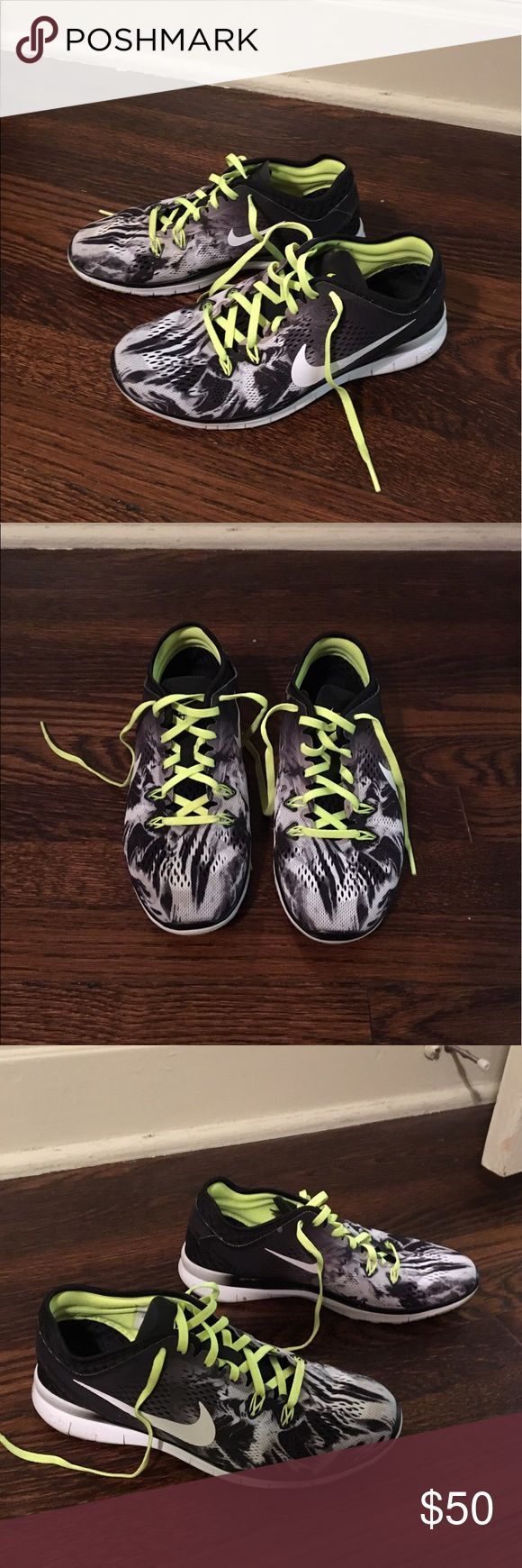 Nike Free 5.0 Barely used women's Nike Free 5.0. Black and neon yellow. Nike Shoes Athletic Shoes