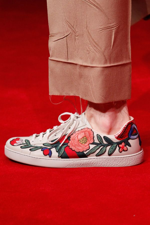 5. Embroidered Sneakers - If you're usuallyresistant to fashion sneakers, Gucci's intricately embroidered luxe kicks have the power to persuade. Wear with wide-leg trousers (bonus if they have an unfinished hem like this look) and you're good to go.