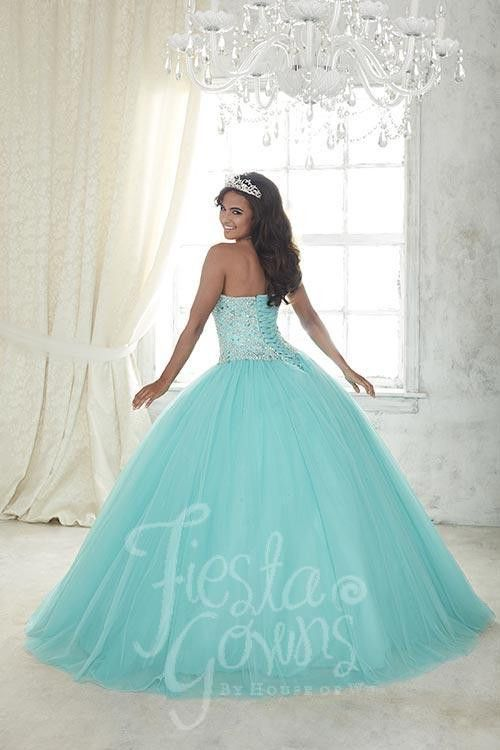 Beaded tulle makes this ball gown a fine selection, along with the bodice splashed with colored replica pearls and shining stones and a sweetheart neckline. Download the Fiesta Gowns by House of Wu si