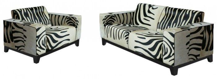 Opvallende bank in koeienhuid met zebraprint. Leuk als eyecatcher in huis of entree. de meubelen worden per klant op maat gemaakt in eigen productie in Nederland. via pakhuis21