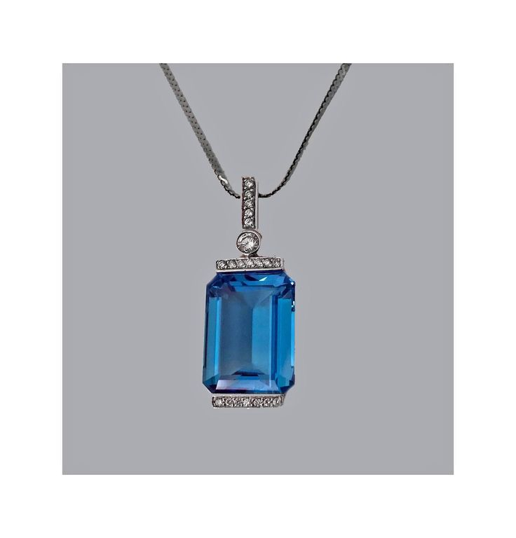 18K Blue Topaz Diamond Pendant Necklace 20th century | From a unique collection of vintage drop necklaces at https://www.1stdibs.com/jewelry/necklaces/drop-necklaces/