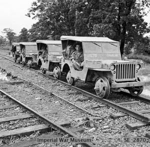 Road-rail Jeeps, used to transport supplies, on the tracks between Myitkyina and Mogaung, December 1944