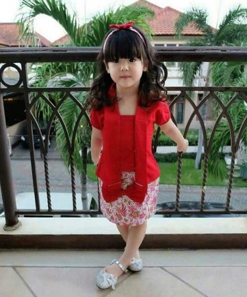 Qute baby with beautiful hairstyles and red shirt