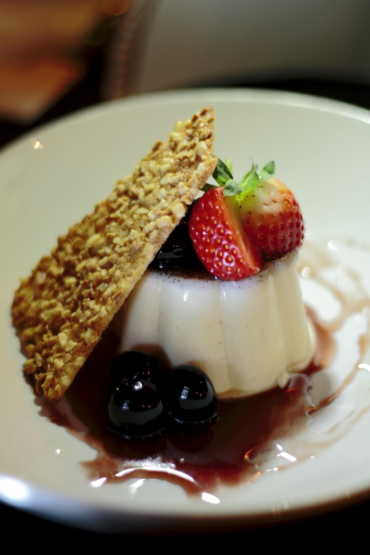 """PannaCotta (Italian for """"cooked cream"""", in case ya didn't know (Panna- cream; Cotta-Cooked). Chef scraped Bourbon beans into the mix, with a Sesame Tuille and heady Amarena Cherries."""