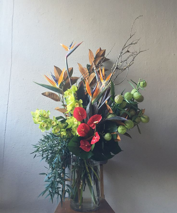 A breathtaking combination of fresh beautiful birds of paradise, cymbidium orchids, anthurium, swan balls, magnolia foilage, gum and monsterra. Order online today at: https://jaclynroma.com/shop/product/the-corporate-flower-bouquet/