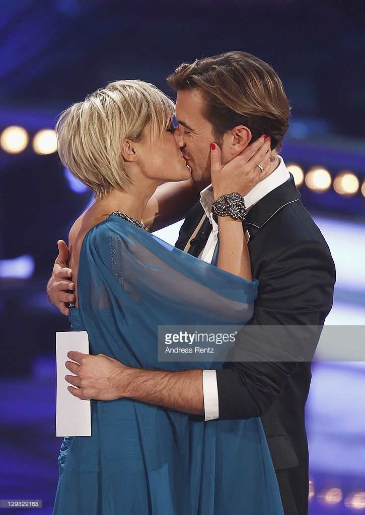 Helene Fischer kisses her partner Florian Silbereisen during the 'Das Herbstfest der Abenteuer' music show on October 15, 2011 in Chemnitz, Germany.