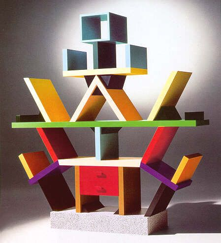 This bookshelf/desk-like thing was designed by Ettore Sottsass, a designer who was known for making whacky eye-catching shelves and cases. (From what i've seen!) The colours on this shelf are bright, and contrast with one another. The overall shape of the shelf mixes in well with the colours.