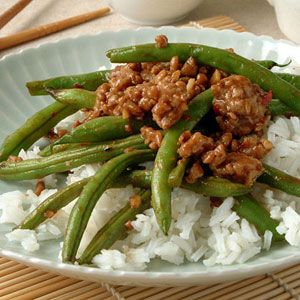 Great recipe! Suggestion: cook the green beans in canola oil alone to blacken them and transfer to a different plate while pork/sauce mixture cooks. Also, add fresh ground ginger to sauce mixture! Sub sesame oil for peanut oil.