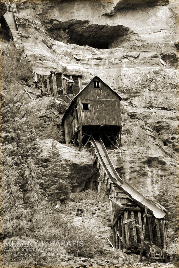 """An abandoned gold mine up the street for our hotel in Ouray, CO.  It's halfway up a steep cliff on a high mountain.  Amazing to wonder how they go up there.  I can only guess donkeys had a rough life back then.  There are no roads up to this pace (that I know of).  """"Abandoned Mine"""" Caption and Photo by Melany S. via Flickr"""