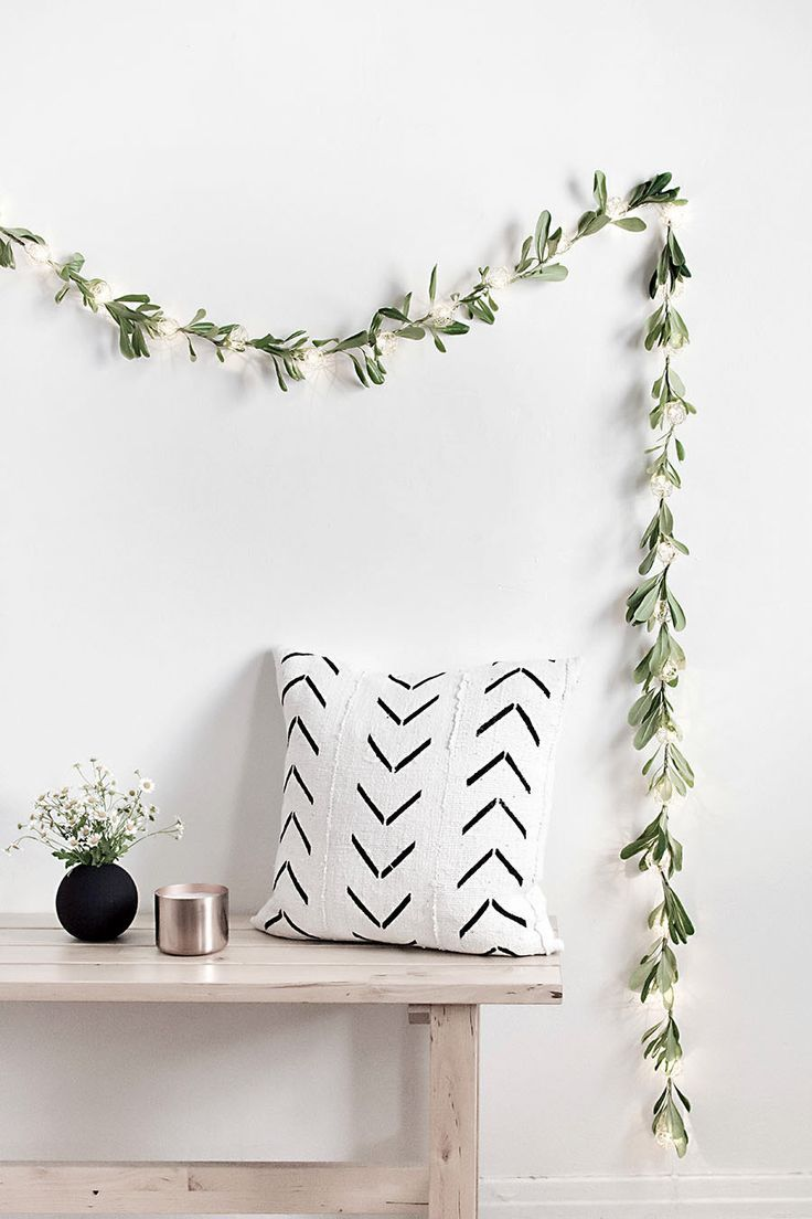 Make this cute DIY string lights garland to add a bit of color to a gorgeous minimalist decor theme.