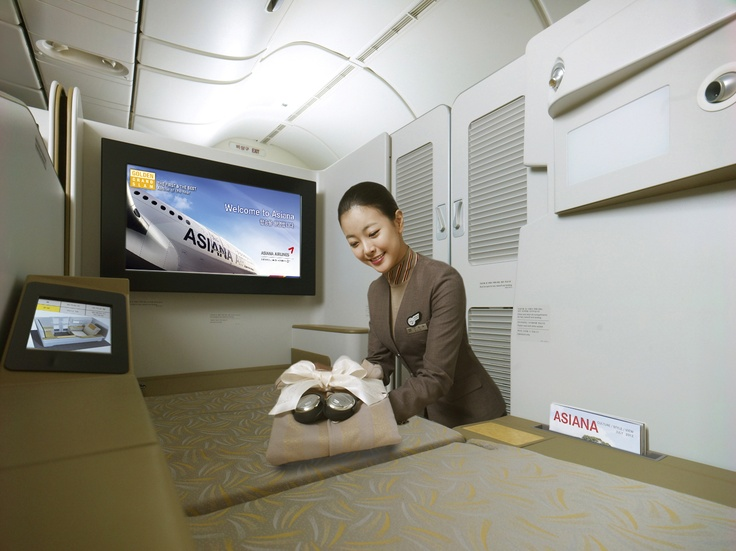 Asiana's new B777(HL8254) has a new type of first-class service, OZ First Suite. The biggest distinguishing feature of OZ First Suite is the dedicated sliding door for each seat to maximize inflight privacy, the first of its kind in Korea, and it has the world's largest 32-inch high-definition inflight personal monitor and a LCD Seat Function Control Unit as well as personal cabinet and mini-bars. More details: http://j.mp/OZmNXg