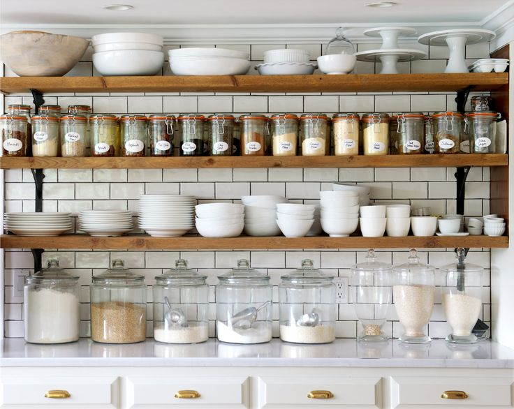The first thing the owner did after moving in was to yank out the upper cabinets in the kitchen and replace them with shelving from Home Depot. (Photo: Jane Beiles for The New York Times)