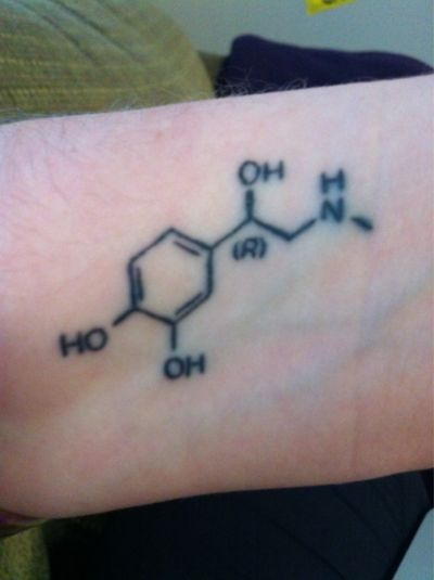 This is the chemical structure of adrenaline.It symbolizes how much of every single day I have it running through my blood. I love the feeling of the adrenaline rush. I have suffered from a series of eating disorders and other struggles so my anxiety can be out of control. I love this tattoo and got it done in Guelph, Ontario. It's unique to me and my story which makes it extra special.