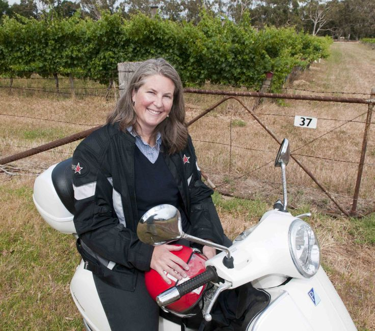 Viticulturist and winner of the 2012 Australian Rural Women's Award Mary Retallack has added yet another string to her bow – as a delivery service of bugs to vineyards. Photo: Mary Retallack on her Vespa. Photo by Philip Martin http://adelaidehills.realviewtechnologies.com/