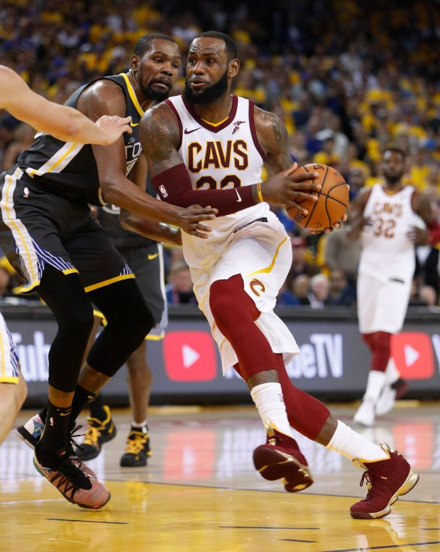 77ef6a5d044 Cleveland Cavaliers  LeBron James (23) heads to the basket against Golden  State Warriors  Kevin Durant (35) in the third quarter of Game 2 of the NBA  Finals ...