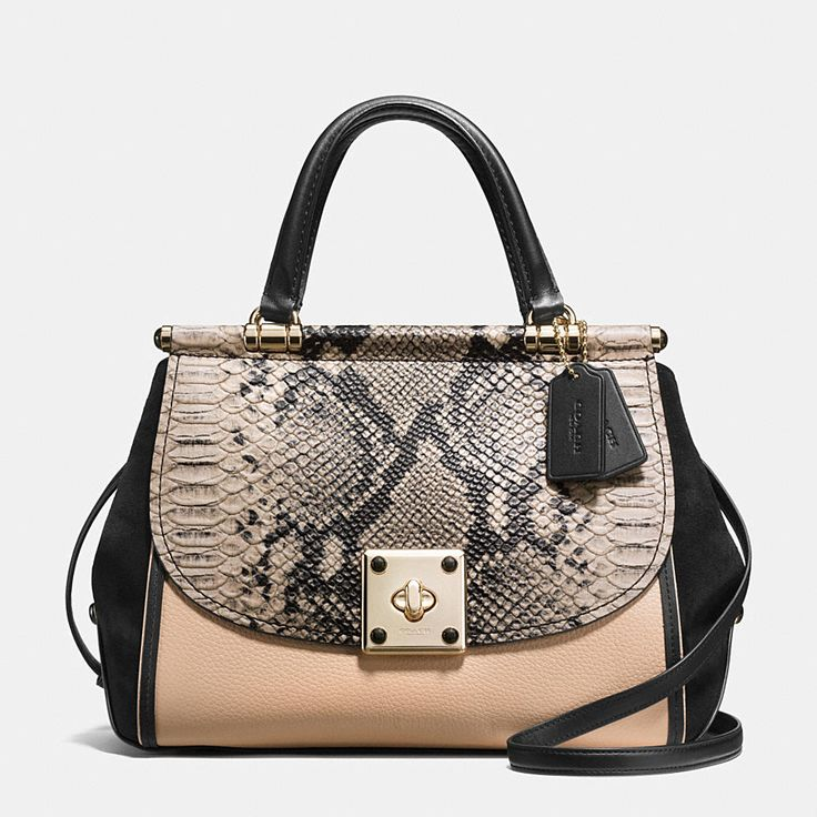 Inspired by archival Coach bag beloved for its clever construction, the spacious…