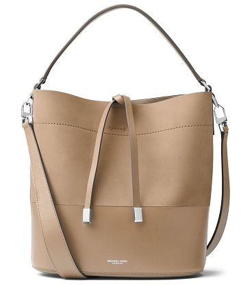 """Miranda medium leather bucket bag by Michael Kors Collection. Structured paneled leather bucket bag with weighted tie. Top handle. Removable shoulder strap, 18""""-22"""" drop. Tie clos..."""