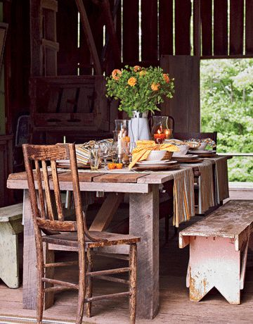 This has to be my favorite farmhose scene..table ..chairs..benches..table setting   love it