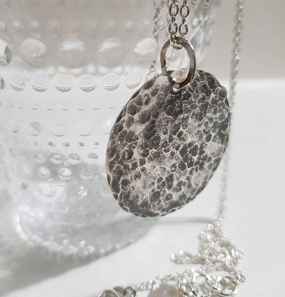 Check out this item in my Etsy shop https://www.etsy.com/listing/540599066/rustic-hammered-sterling-silver-circle