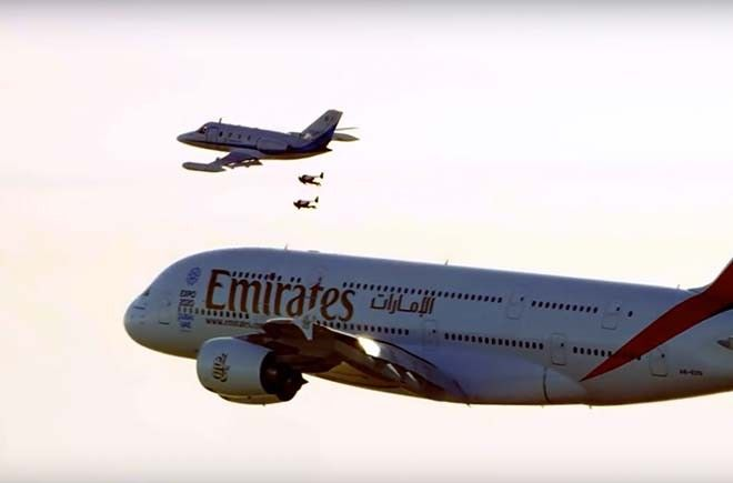 Emirates Airlines Stewardess Pour Unused Champagne Back Into - Crazy video of two guys flying jetpacks over dubai