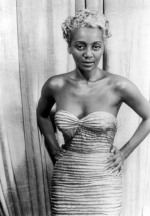 Joyce Bryant, an African American blues and jazz singer with a four and a half octave range. She's seen here with silver hair.
