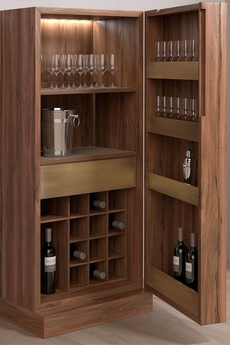 Weekly cabinet by Pacini & Cappellini with veneered and solid Canaletto walnut structure. Inner partitions and shelves veneered and covered in leather, drawers and open units veneered with front in burnished metal.