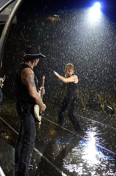 Richie Sambora and Jon Bon Jovi during Bon Jovi's 'Bounce Tour' Live at Giants Stadium on August 7, 2003 - Show at Giants Stadium in East Rutherford, New Jersey, United States.