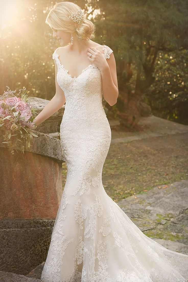 I love a wedding dress that highlights beautiful shoulders. What a stunning lace over satin bridal gown!
