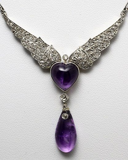 Amethyst, diamond, platinum and 18K gold pendant necklace, English, 1920s. The pendant designed as wings set with rose-cut diamonds, centring a heart-shaped amethyst and suspending an amethyst drop.