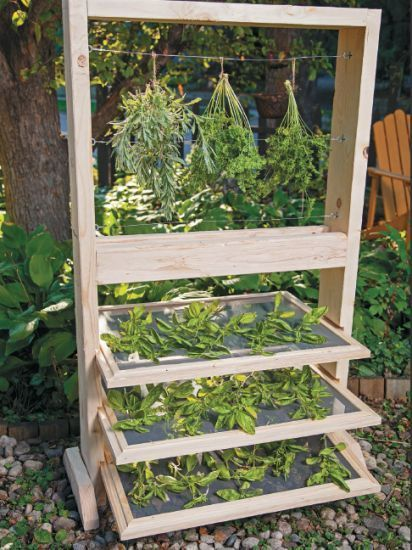 Growing herbs this year? Build this DIY Herb Drying Rack to preserve and enjoy them all year long!