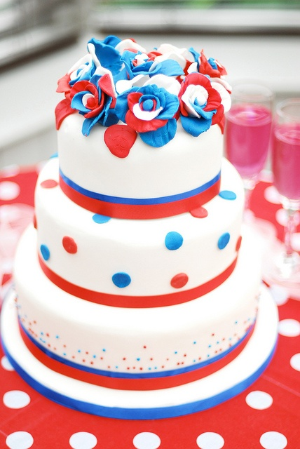 A gorgeous, eye-catching red, white and blue cake to celebrate all things UK related. #wedding #cake #UK #British #Britannia #birthday #fancy #layered #tiered #July_4th #summer #flowers