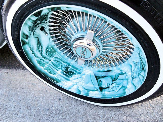 Wow... now that's going all out on your lowrider with murals on your outer rim. Cool idea.