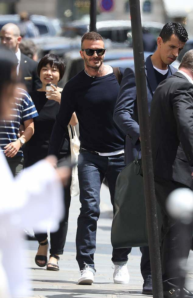 9b9b9f3c1c David Beckham Steps Out In France Rocking Kent And Curwen Sweater And Ray-Ban  Sunglasses