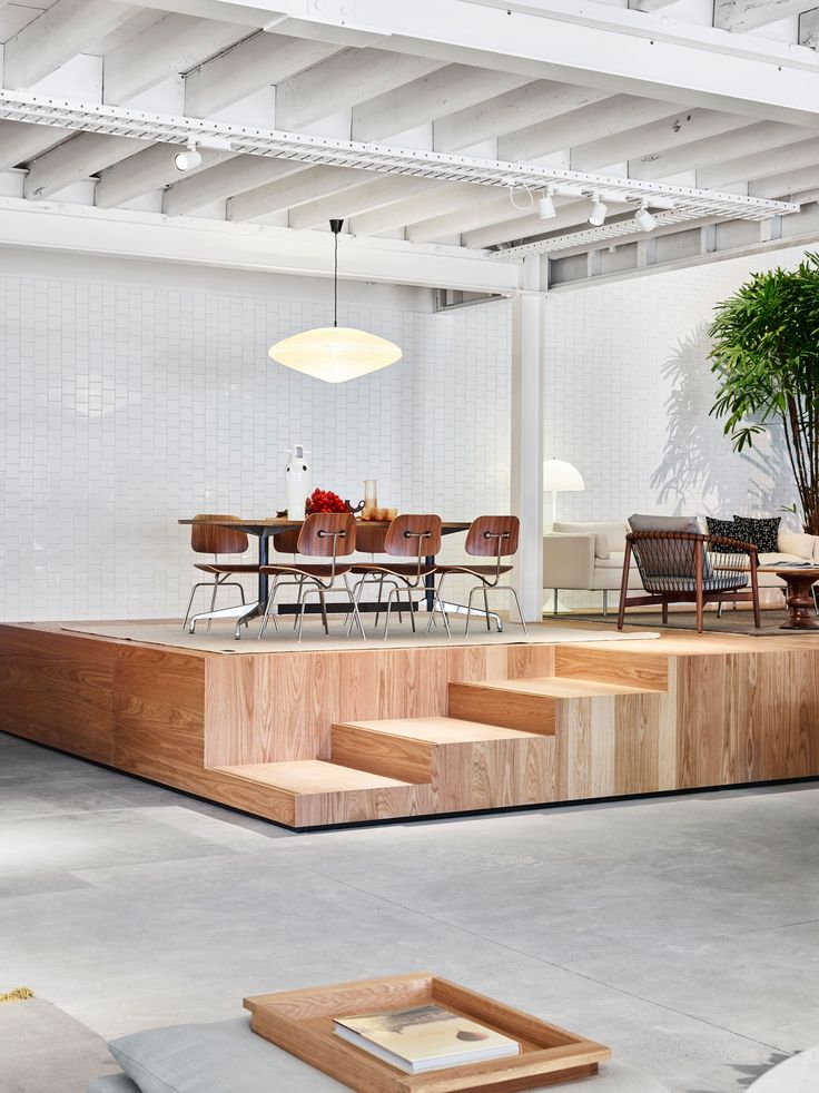 Wish the platform was not floating, but love the design up. Living Edge Brisbane Showroom | Yellowtrace