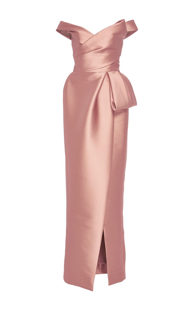 This Monique Lhuillier gown features an off the shoulder neckline, a wrap effect at the bodice, and a full length column skirt.