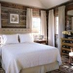 log cabin bedroom in Bedroom Rustic with dresser beige bed skirt