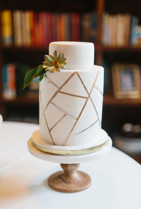 Metallic Linear Wedding Cake. We're loving the linear, metallic design on this white wedding cake.