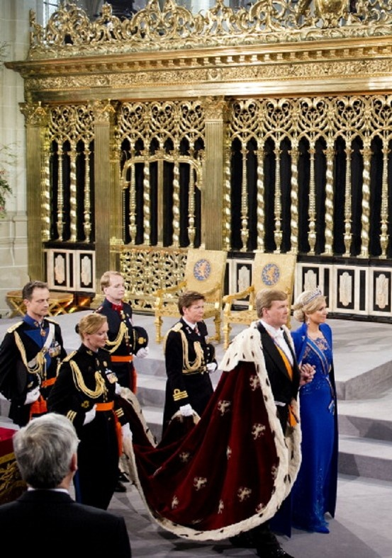 30 April: HM King Willem Alexander of the Netherlands leaves with HM Queen Maxima of the Netherlands after their inauguration ceremony at New Church