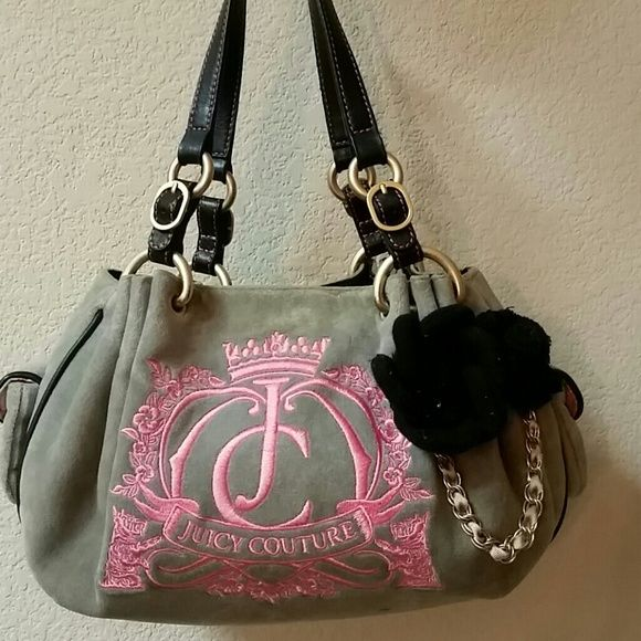 Authentic Juicy Couture Purse Bag Authentic Juicy Couture Purse. Great used condition. No rips or tears. A bit dirty from use. Leather bottom and straps. Juicy Couture Bags