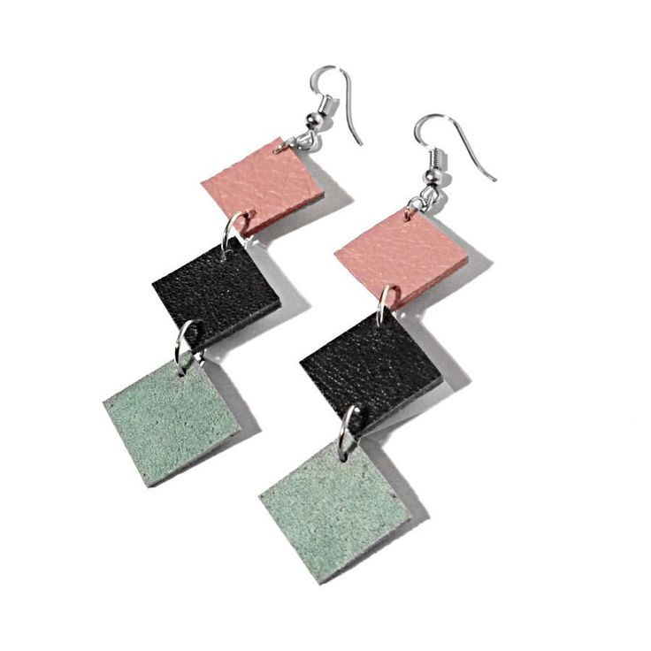 Upcycling earrings made out of recycled leather and leftover leather pieces. These earrings frame your face delicately, make your neck look dainty and are definitely different.