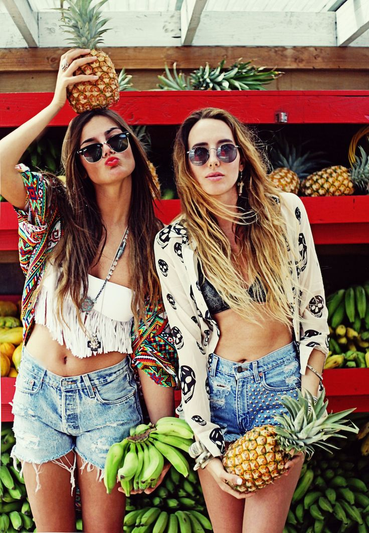 Let us just take a moment to take this picture in. They are posing in front of a pineapple cart. The duck face is present. Tribal print, studs, skulls, fringe, and high waisted shorts are all in the same picture.