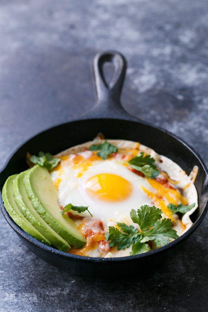 Your morning isn't complete until you've tried this skillet huevos rancheros recipe. With refried beans, cheese, avocado and cilantro, this breakfast recipe will make your tastebuds do a happy dance.