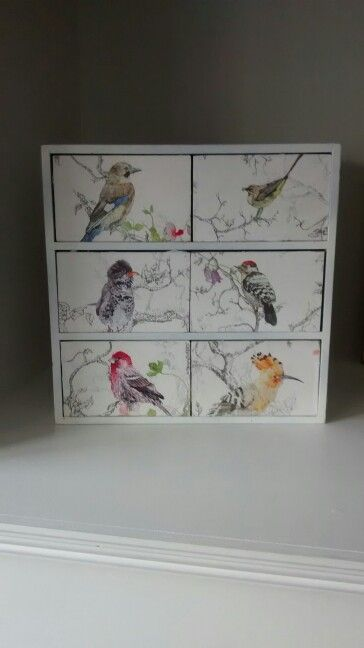 Decoupage Ikea Moppe drawers. Used wall paper from my niece's bedroom