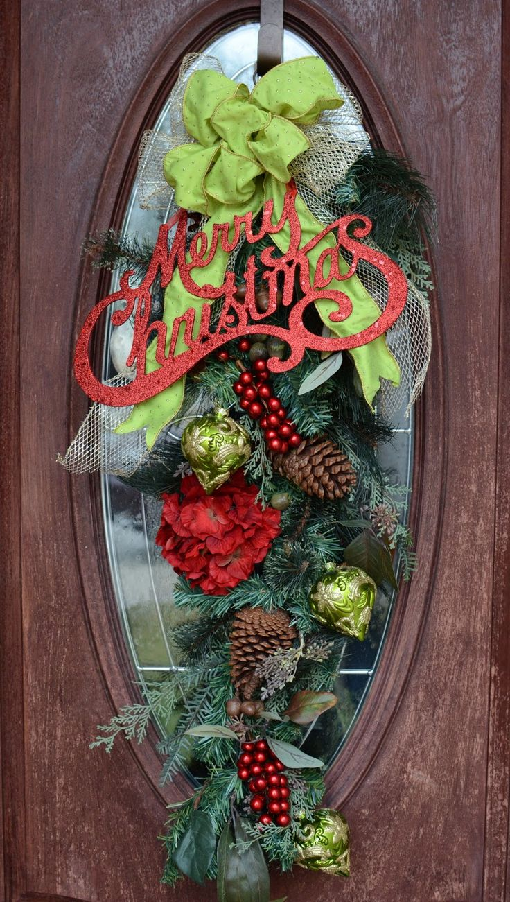 A Great Christmas Swag For A Front Door With An Oval Glass