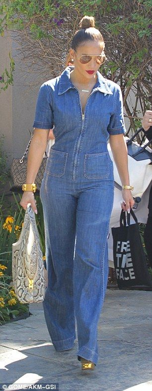 Denim darling: Jennifer looked comfortably chic in a denim jumpsuit with golden heels