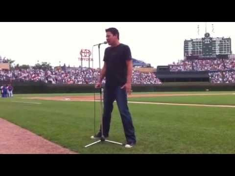 """Big head """"Todd Park Mohr"""" sings the national anthem."""